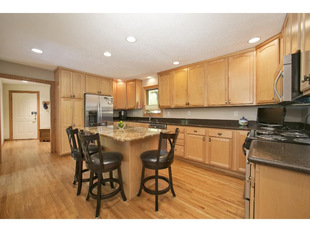 Kitchen with Stainless Steel Appliances, Granite Countertops and Real Hardwood Floors.