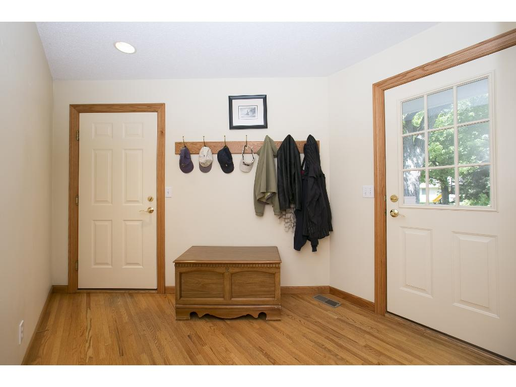 Mud Room Entrance off Kitchen and Garage.  Easily add Storage Lockers and Bench.