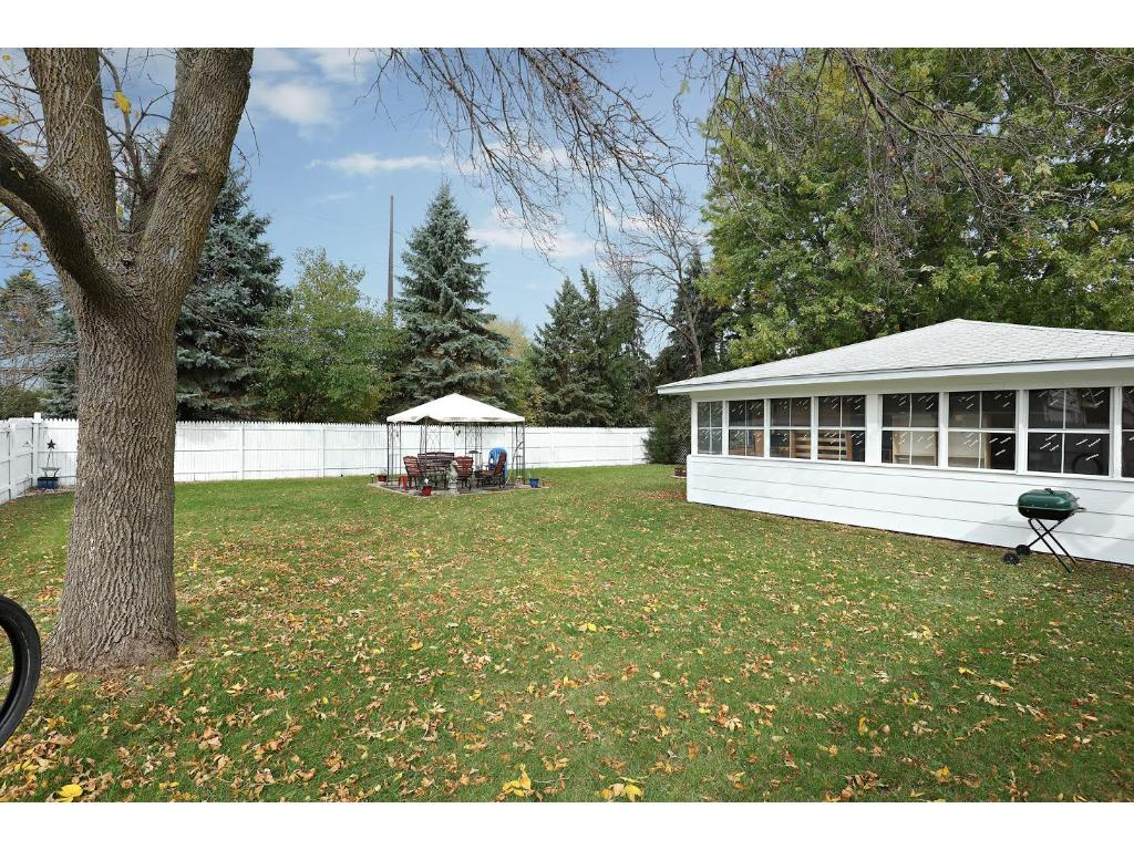Large Garage with 3 Season Porch overlooking the Fully Fenced Flat Yard! A Great Place to Relax or Gather with Friends.