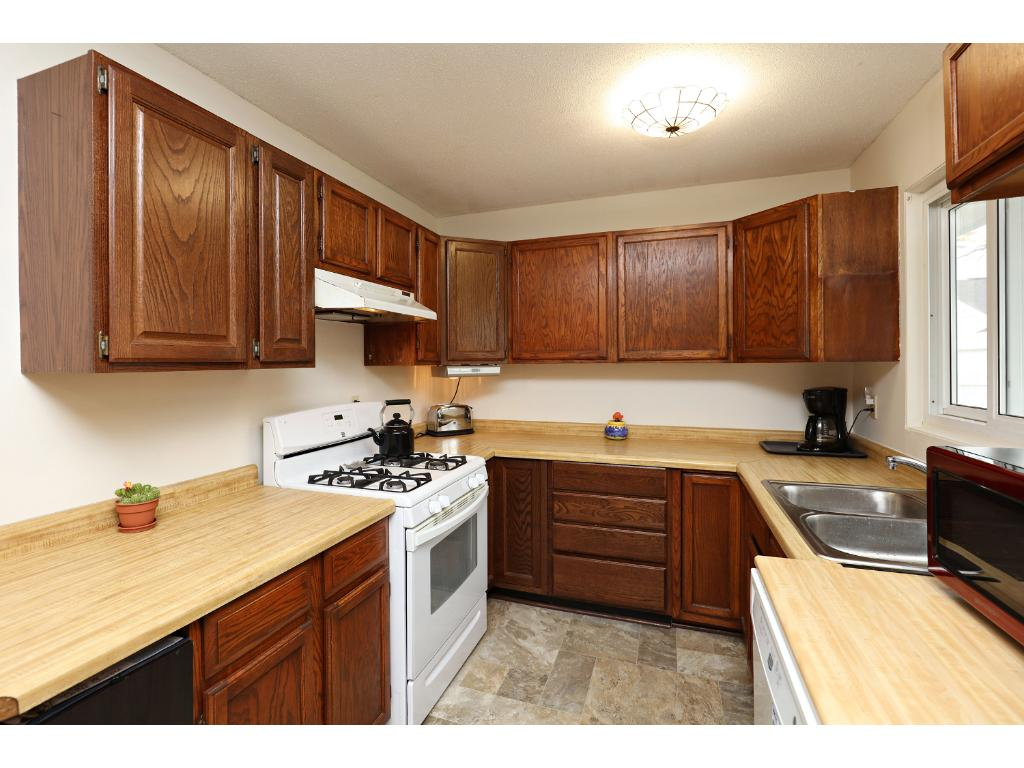 Bright Kitchen Offers Plenty of Cabinets and Counter Space!
