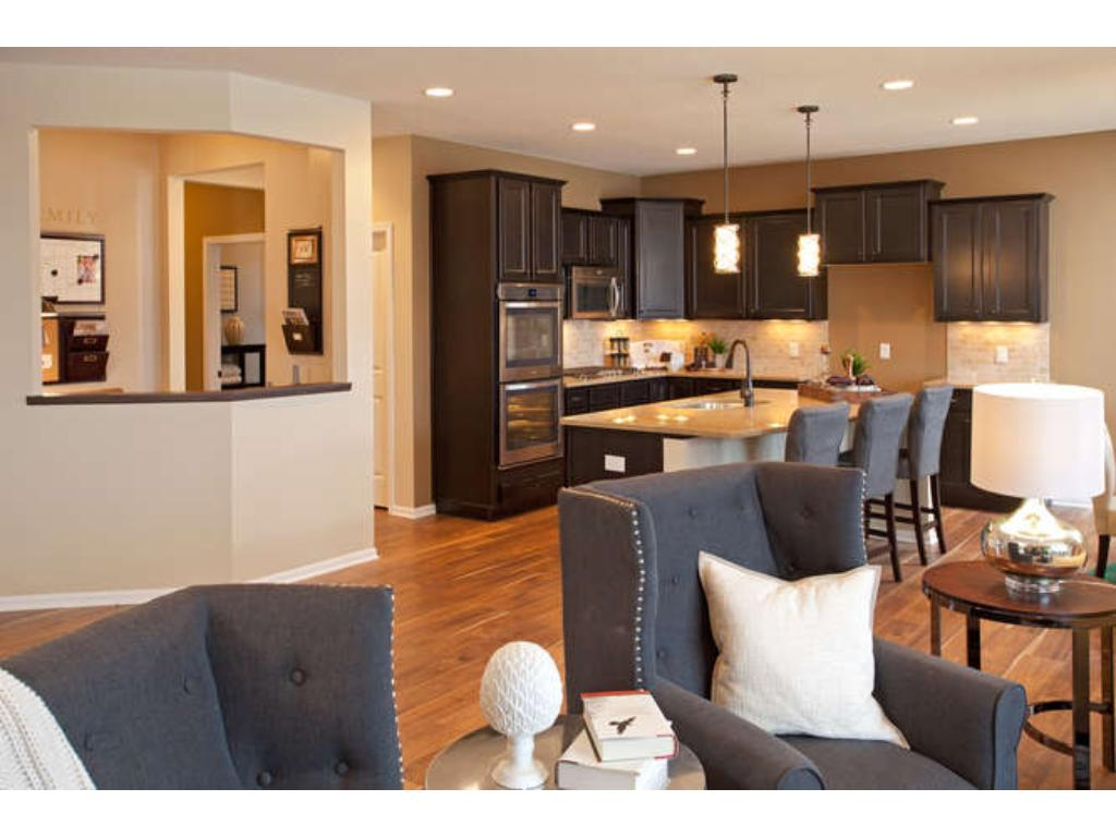 Photo of a Model - Amberwood provides open and airy layout with spacious Kitchen, informal Dining room and inviting Living room.