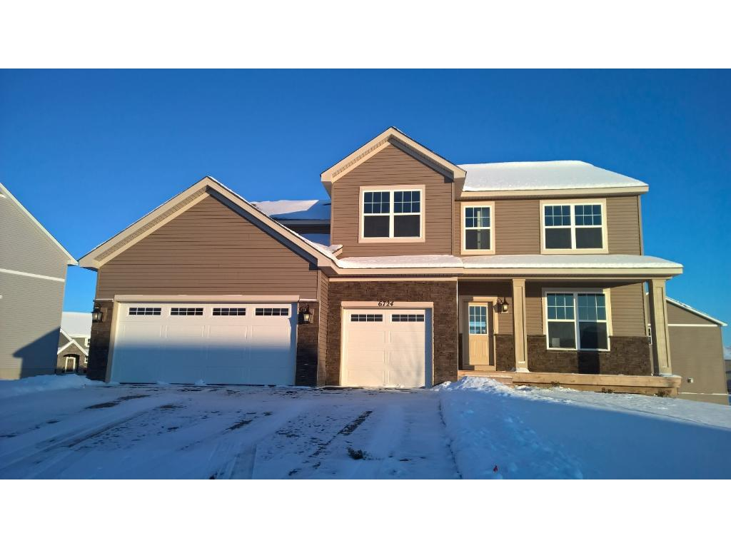 Completed new construction. Welcoming curb appeal, cozy front porch and three stall garage.