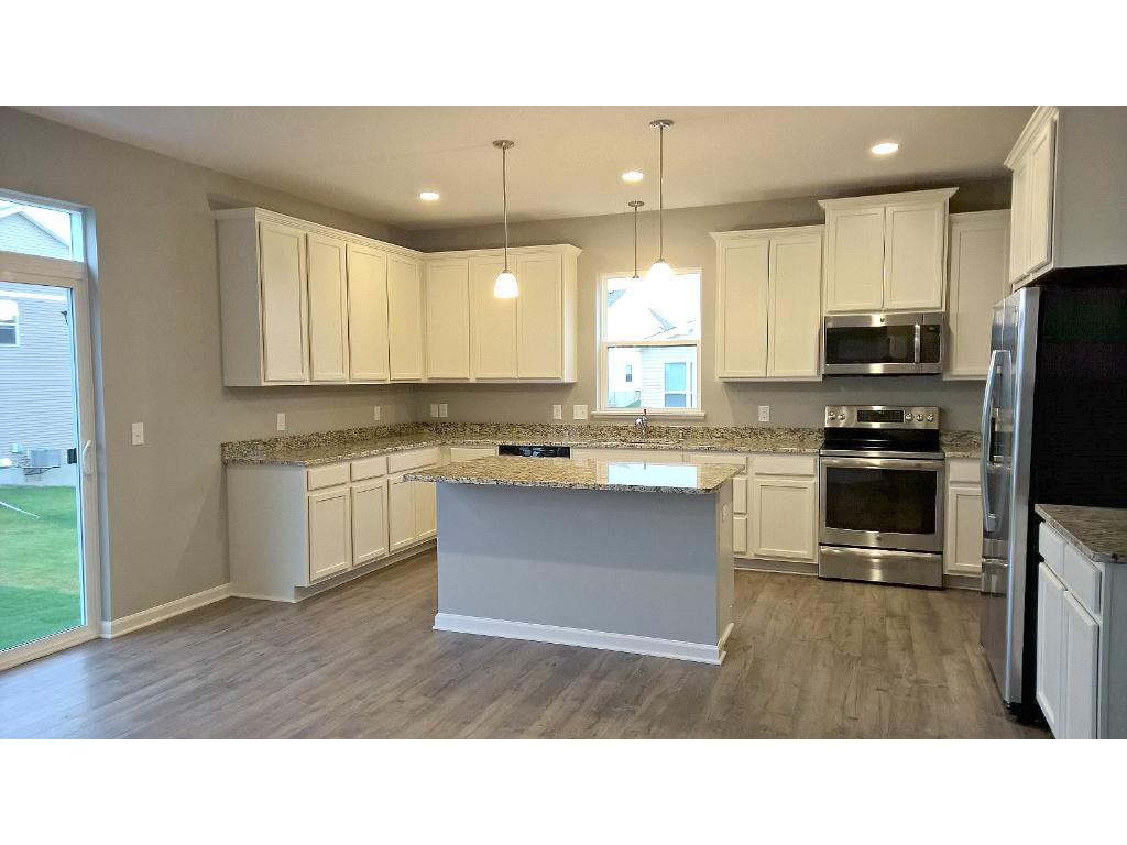 Center island perfect for entertaining with granite countertops.