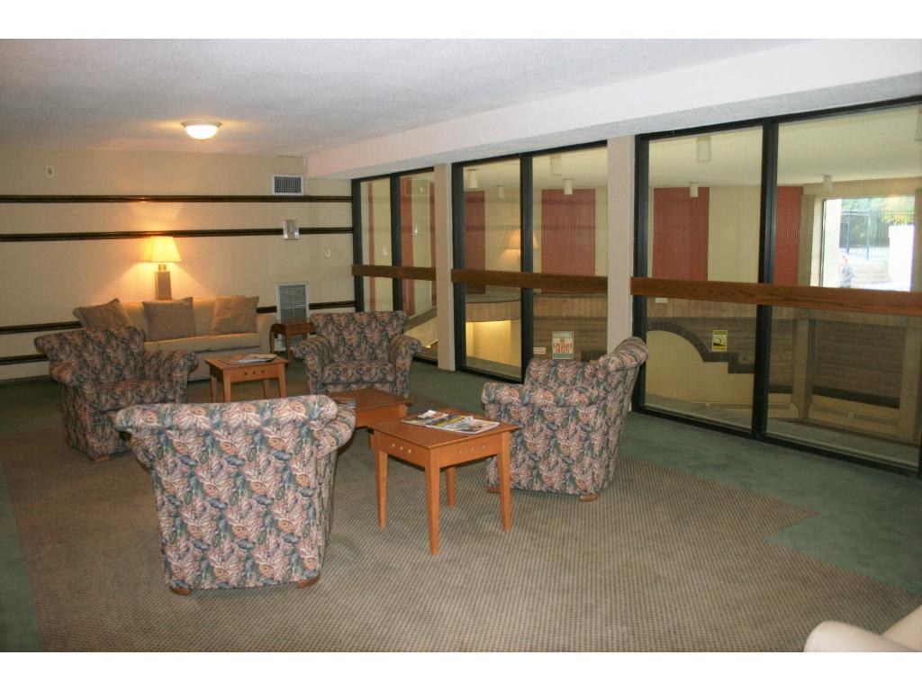 Relaxing lounge area overlooking indoor swimming pool.
