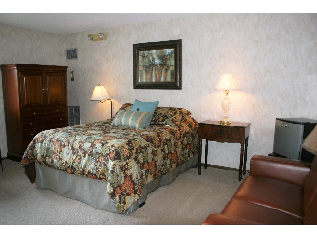 Guest room with private bath and mini-frig available for rent in the building. Invite the relatives for a visit!