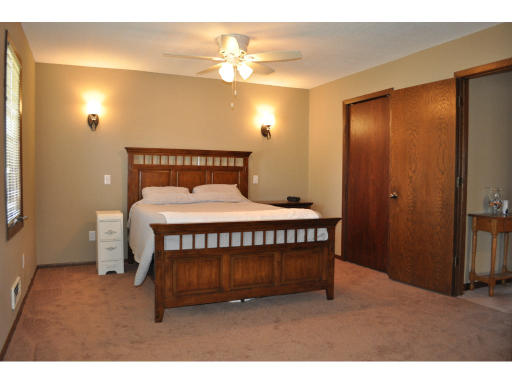 Walk through to remodeled master bedroom featuring a walk in closet