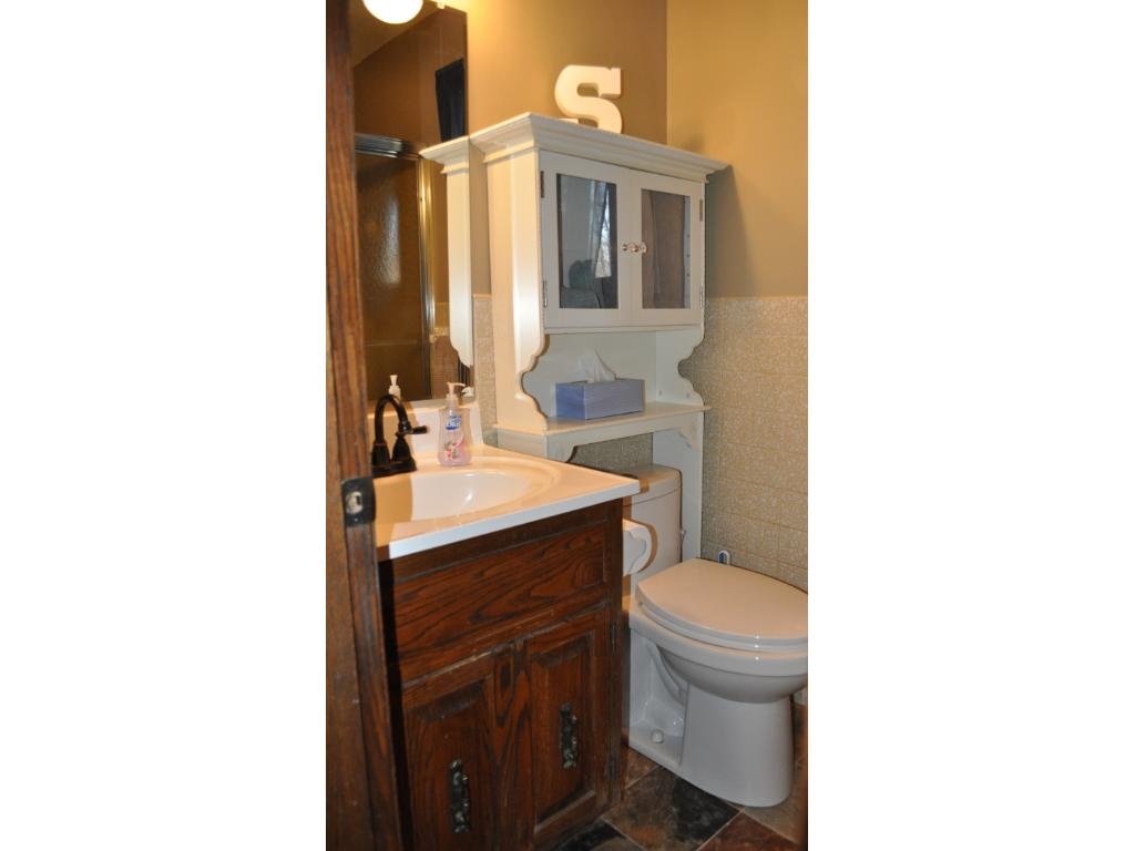 Main level 3/4 bath is conveniently located next to the front entrance