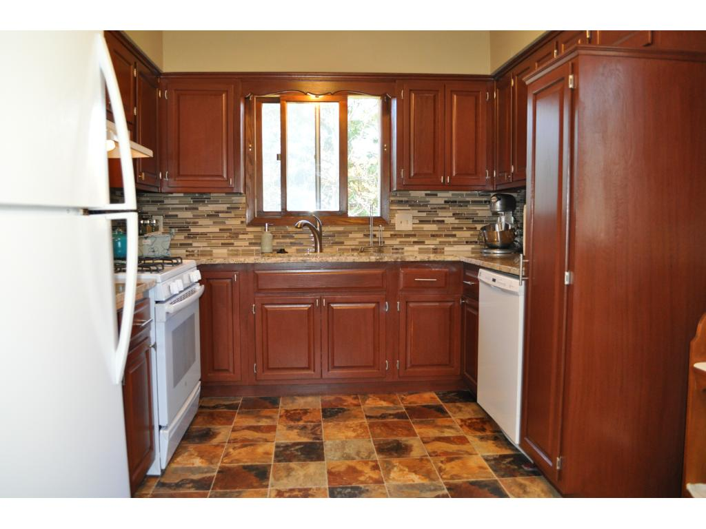 The kitchen was remodeled n 2015 with new cabinets, flooring, backsplash and appliances