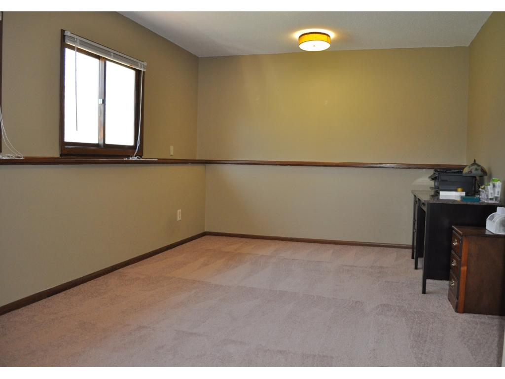 The lower level room can serve as an office, recreation room or even a 5th bedroom