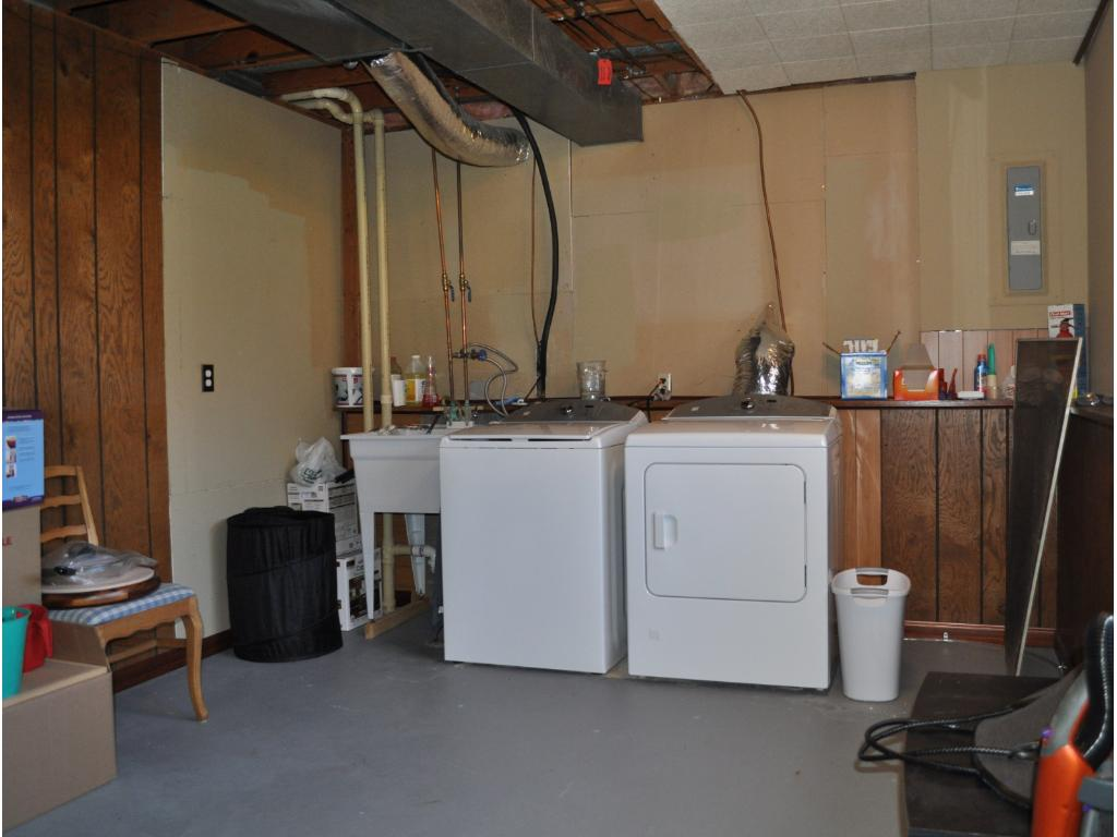 Laundry area includes a utility sink and storage space