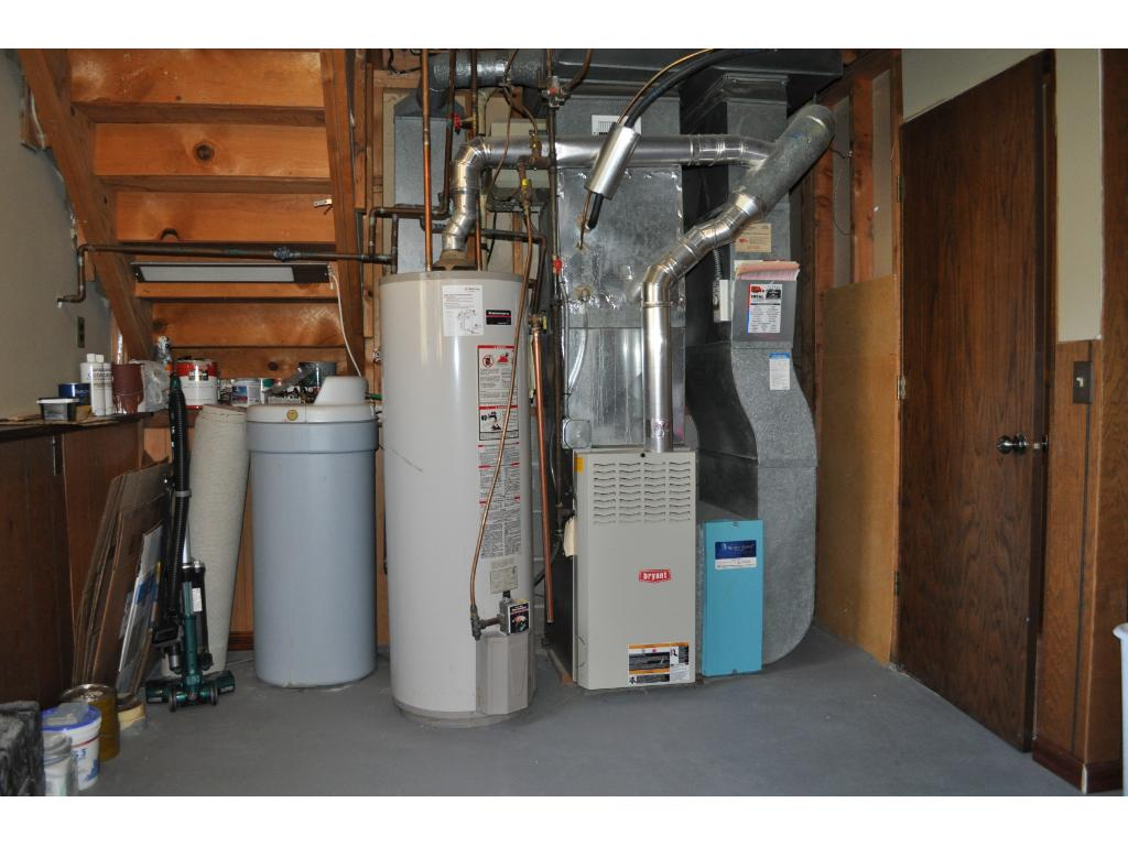 The furnace, water heater and water softener are all efficiently grouped together at the south end of the laundry/storage area
