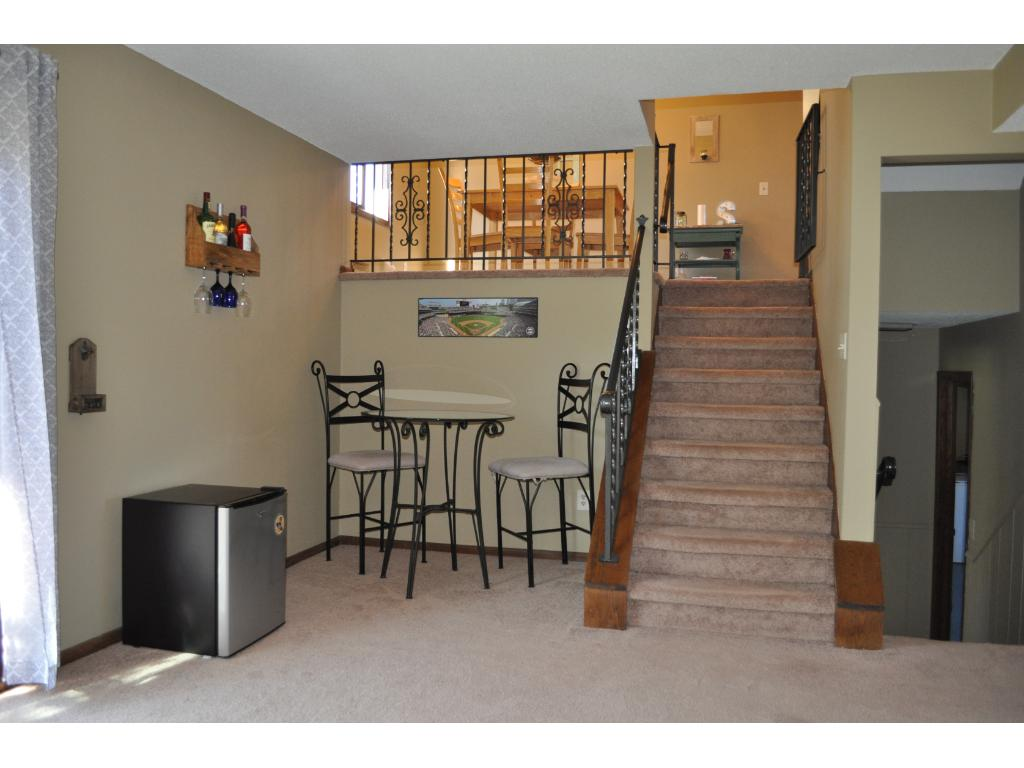 The north end of the family room looks up to the dining area and shows the second set of stairs.