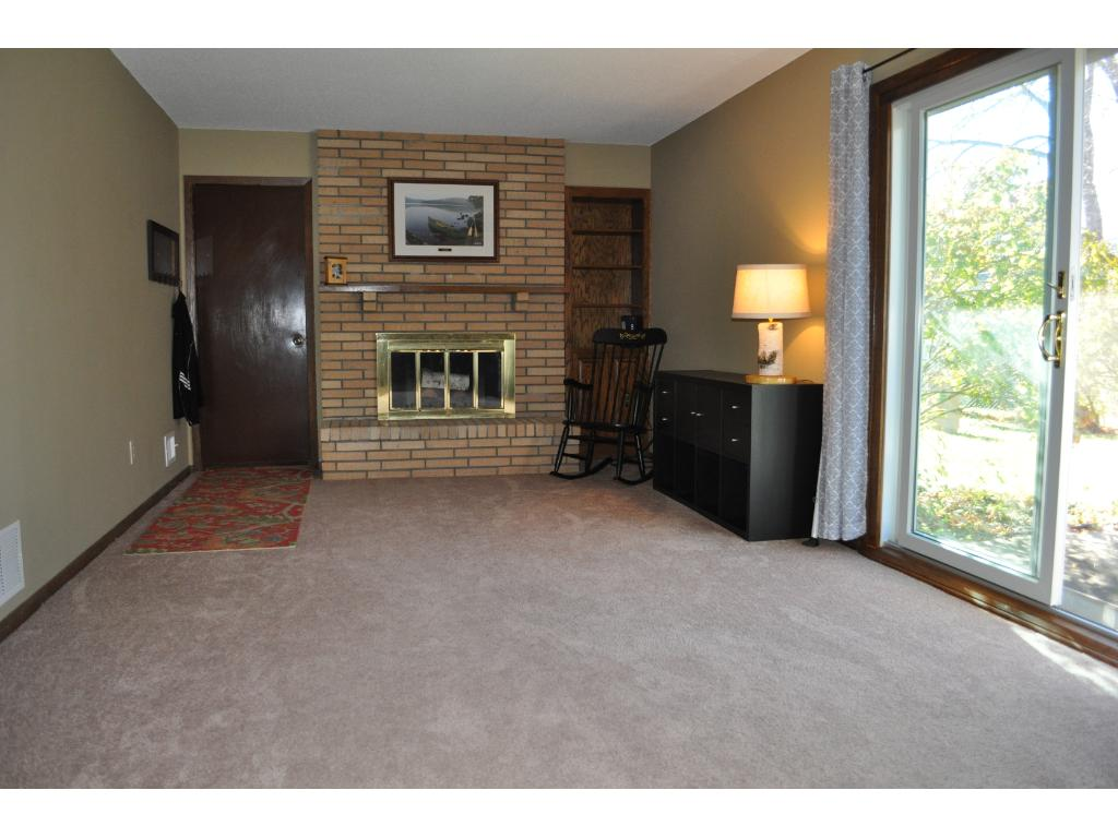 The family room features a fireplace and access to the backyard patio through the sliding glass door.