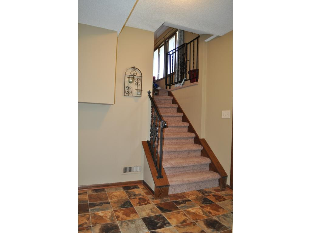 Roomy entryway with one of two sets of stairs to the upper living level