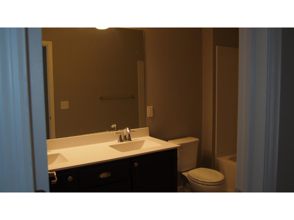 Picture of the model home.  This home includes Luxury Vinyl tiles at the Hall bath.