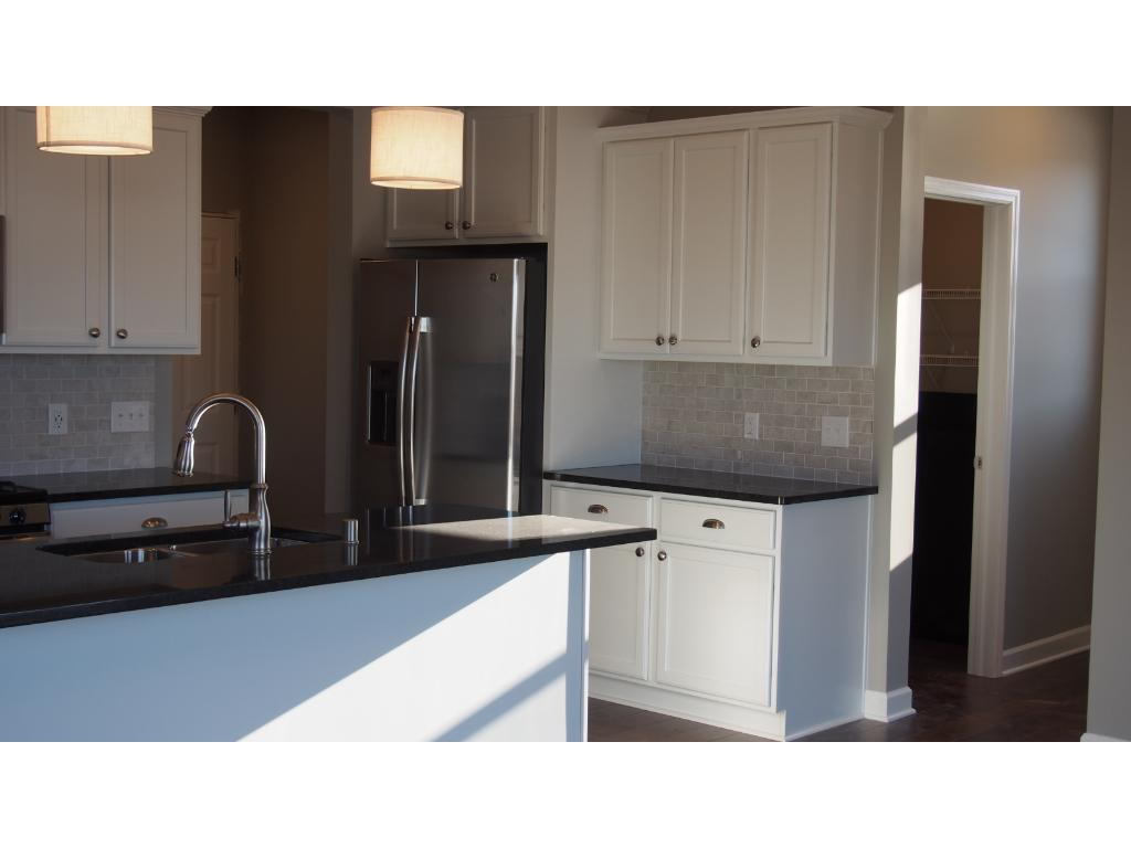 Picture of model.  This home includes wood floors at the Foyer, Kitchen and dining area.