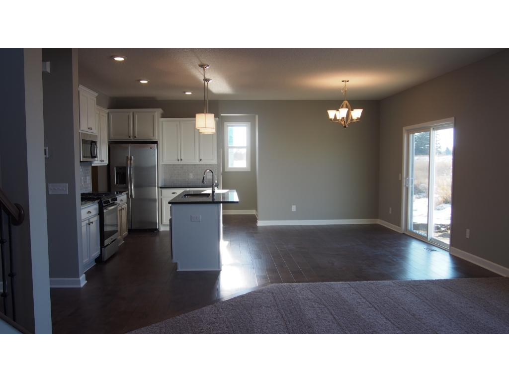 Picture of the model home. Great open floor plan.  The kitchen looks into the Dining area.
