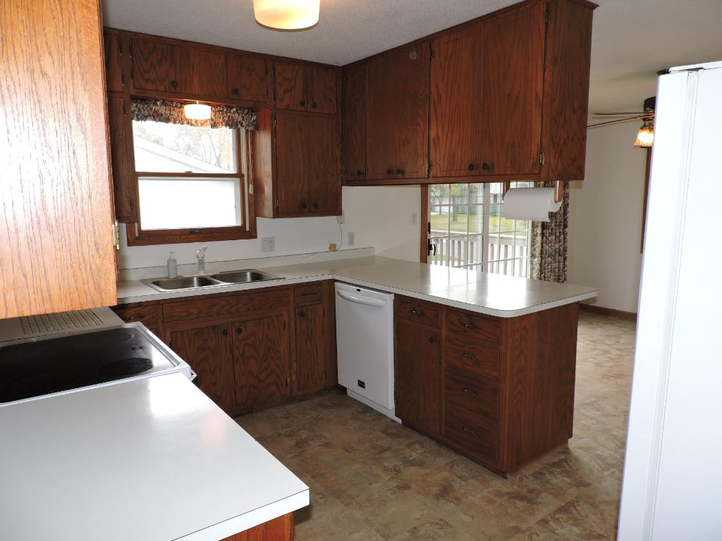 Kitchen w/peninsula and lots of cabinets.