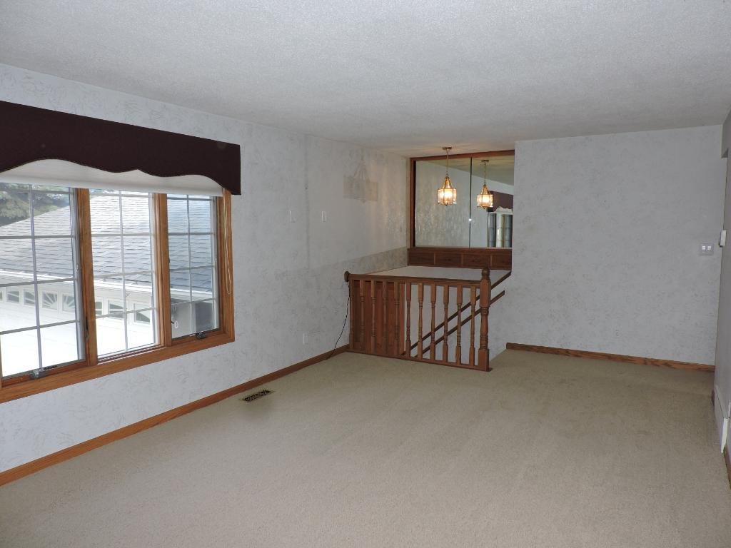 Large living room w/new carpet.