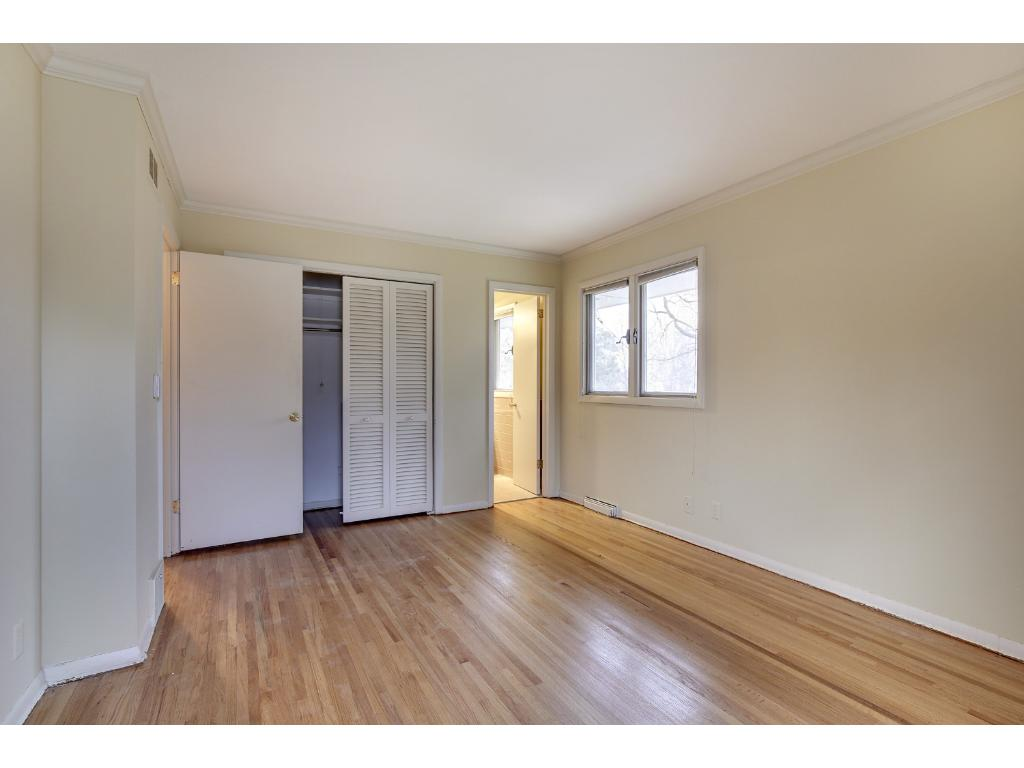 Master Bedroom with newly refinished hardwood floors.