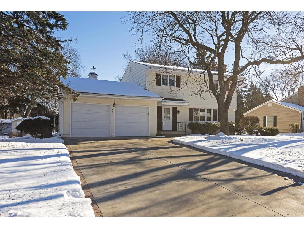 Chapel Hill home with cement drive & two car garage. Easy access to Edina High school, Valley View Middle School & Creek Valley Elementary.