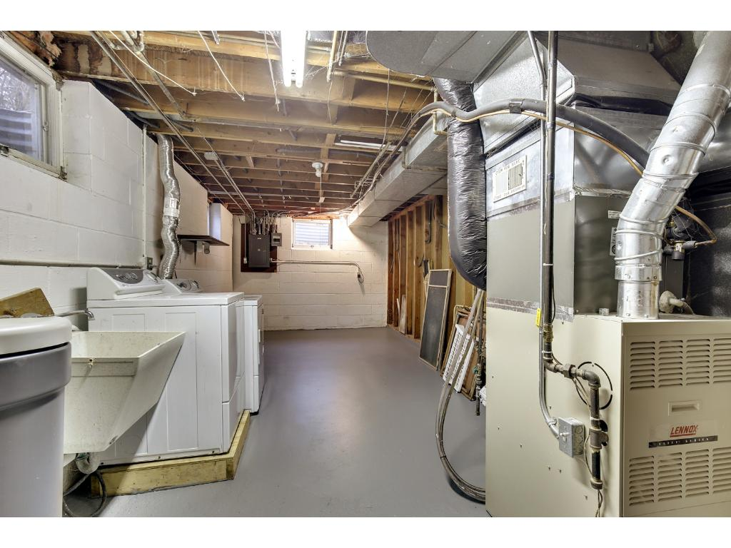 Utility room with laundry.  Additional storage...