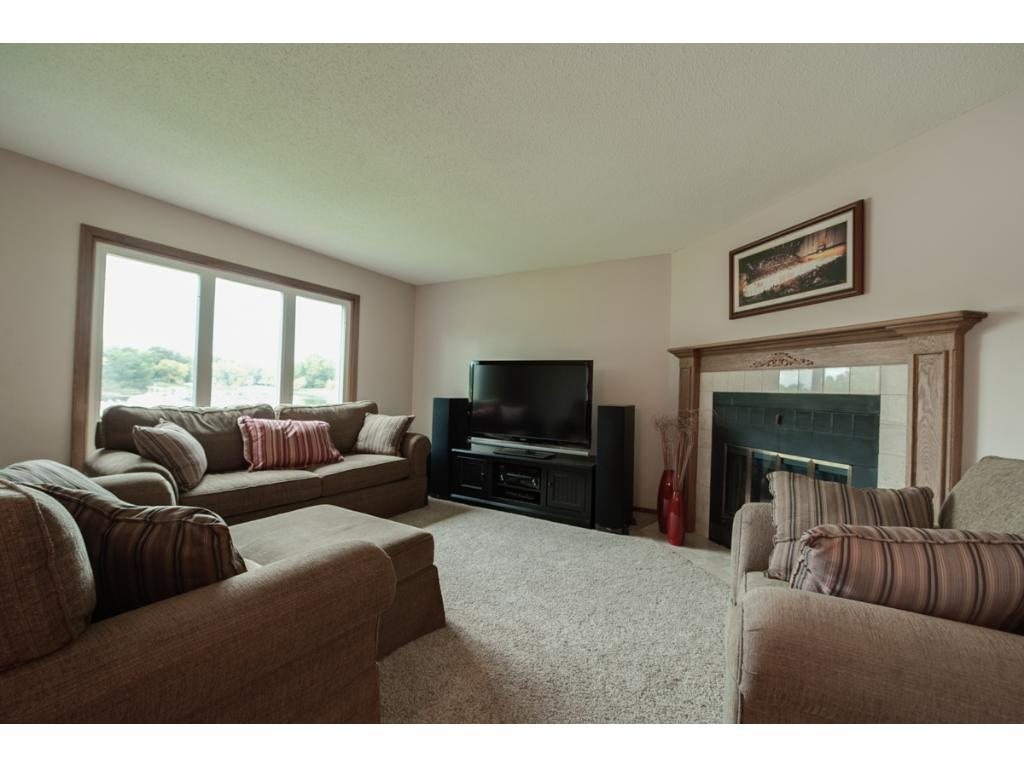 Living room has great views of the lake, corner gas fireplace and open to the dinette area