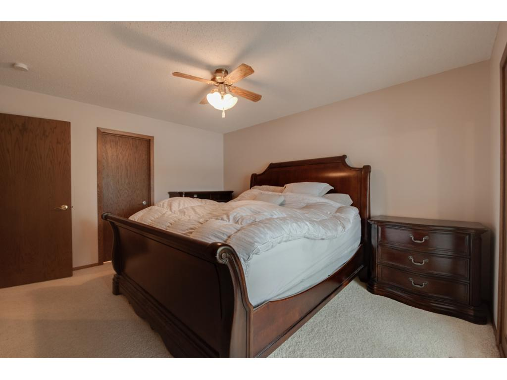 Owner's bedroom is spacious with attached four season porch that overlooks the lake!
