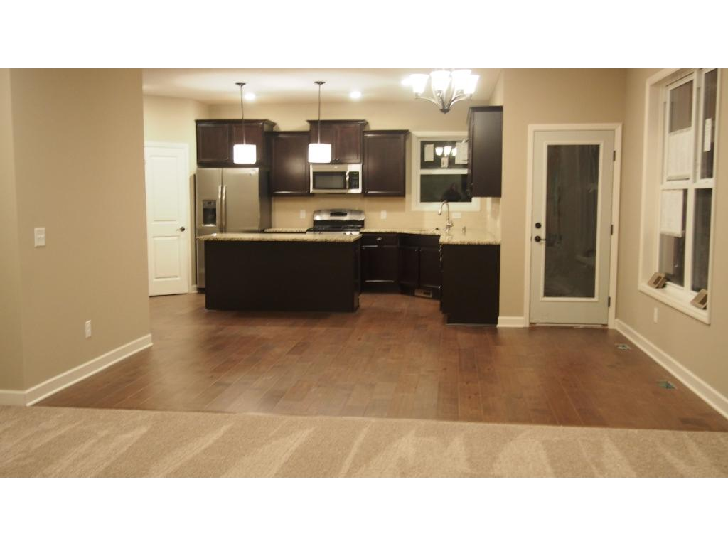 Kitchen includes granite countertops, stainless steel appliances and kitchen backsplash.  Picture of previous model.