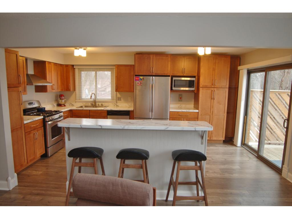 Welcome Home To This Wonderful Kitchen Remodel With Ample Cabinet Space.
