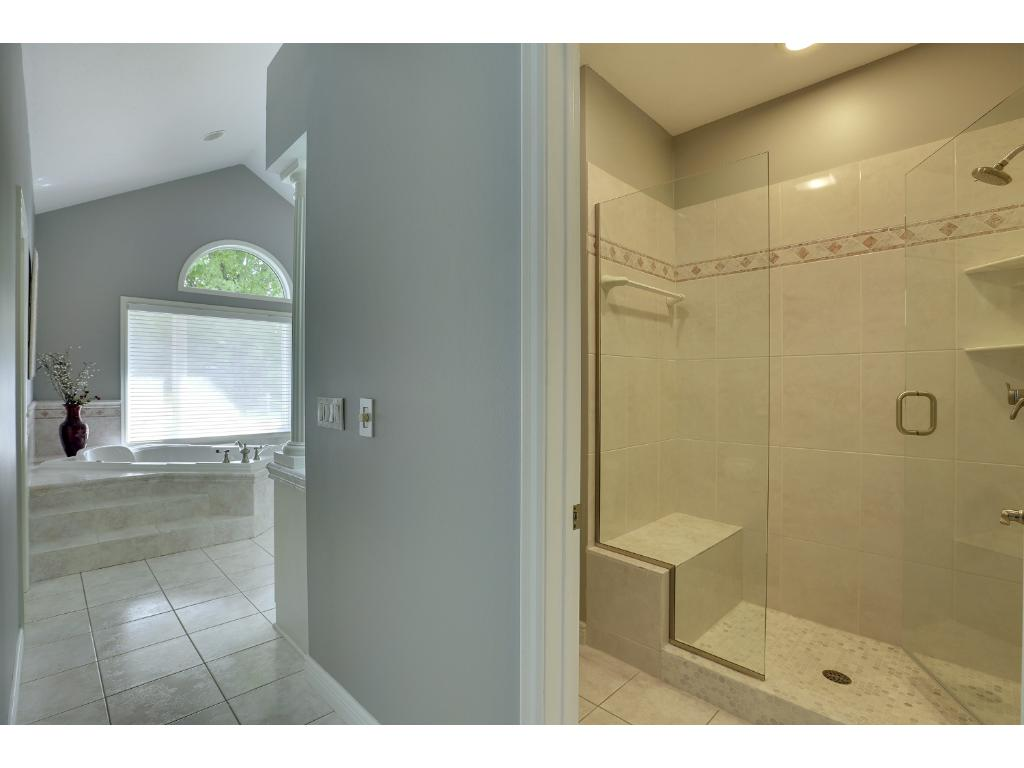 As you walk down the hall to the Owner's bath, you pass the newly tiled shower/stool area on the right.  There is a generous walk in closet with closet system on the left.