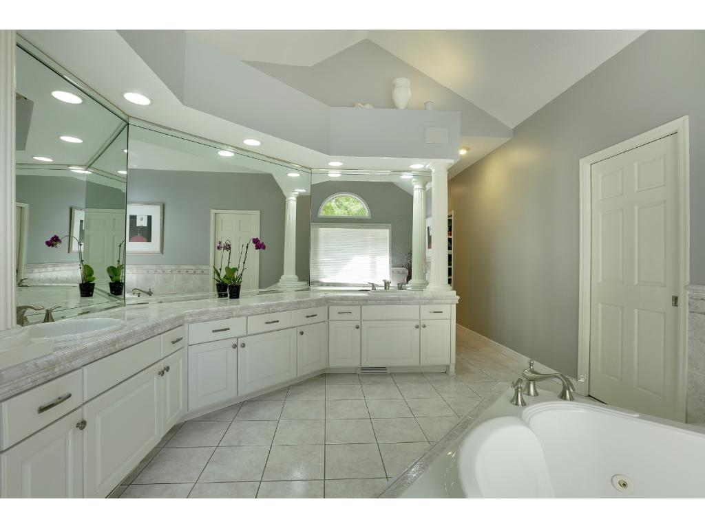 Double sinks, two person whirlpool, dramatic windows, lighting and mirrors.  Plenty of room for two people to get ready at the same time.