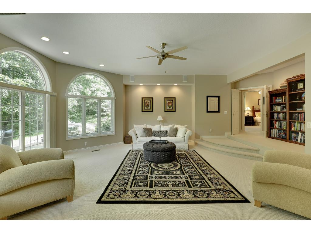 The recreation room has 2 steps that go down for added drama.  Enormous Palladian windows on this level too!  To the right are two more bedrooms and a bath.