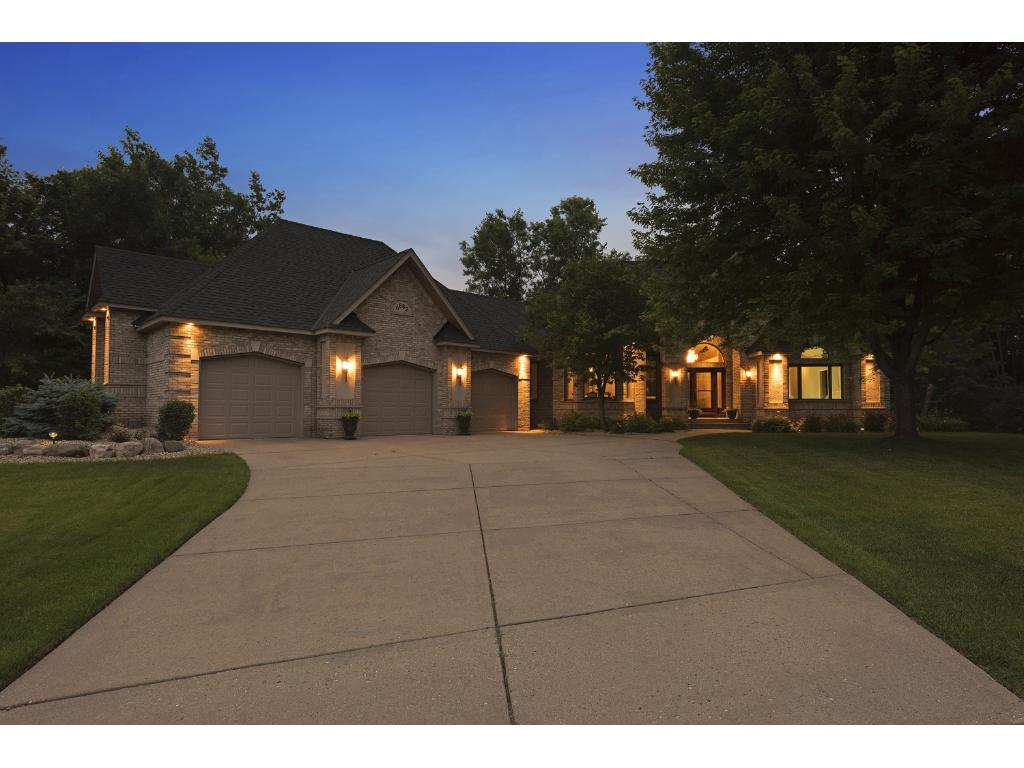This home has so much curb appeal during the day or at night.  Here is a photo at dusk.  Come see this home in person!
