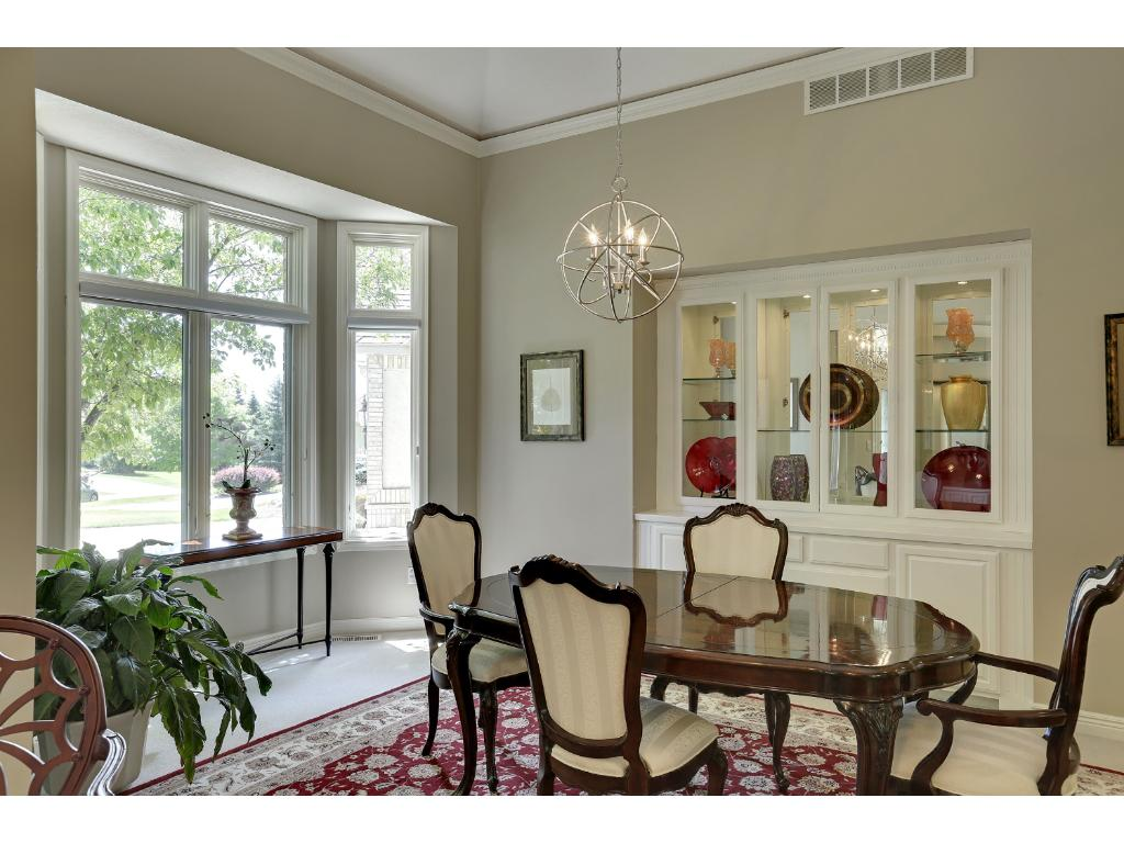 The windows in this home are over the top.  Amazing light no matter where you are.  Transom windows in the dining room.  The buffet is built in.