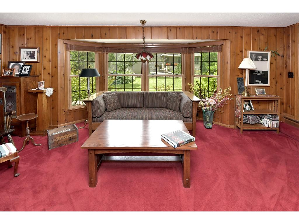 The study is the one room in the home which the sellers wanted to keep and maintain as the original look of the home.  Lots of woodwork and natural sunlight!