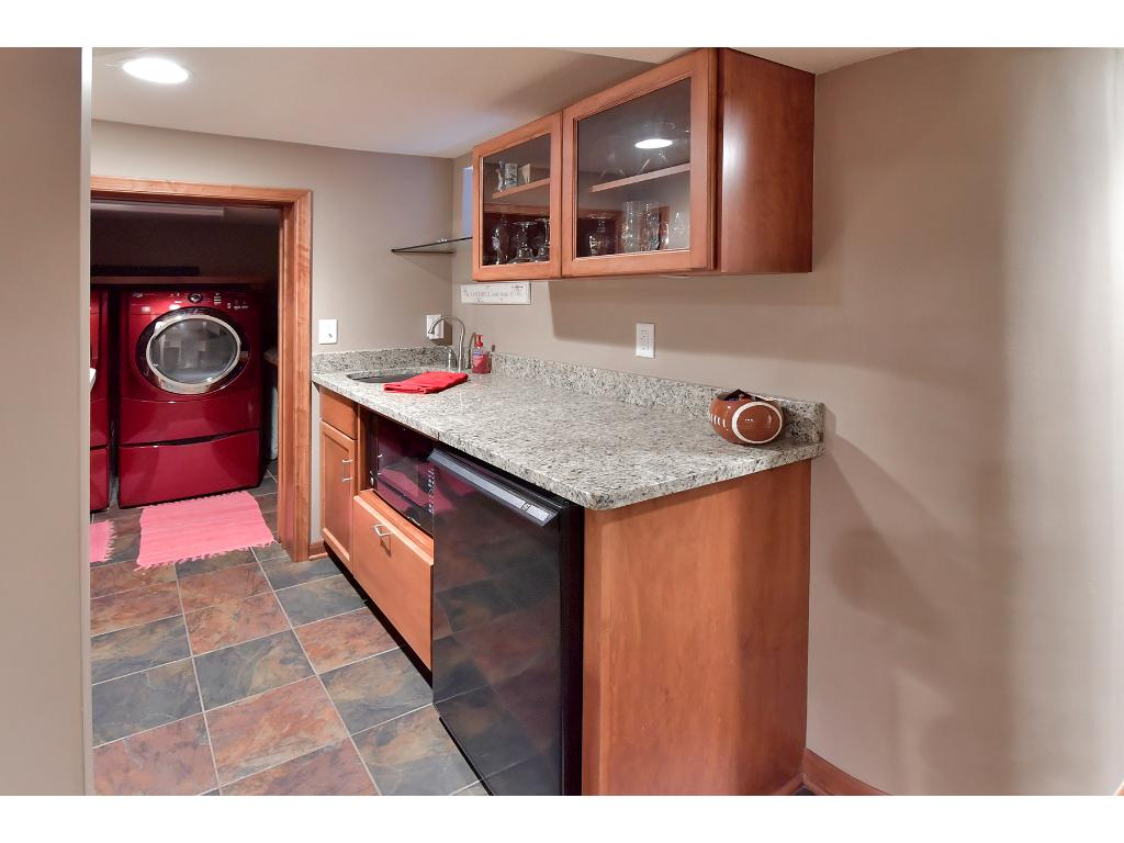Enjoy the fabulous wet bar just off the family room.  The laundry room is also located in the lower level.