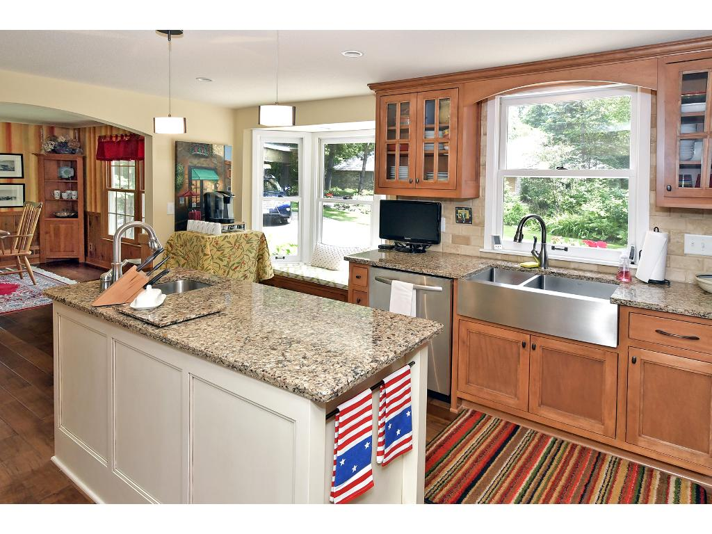 Enjoy the abundance of cabinetry, wonderful granite countertops, beautiful hardwood floors and a built in hutch with wine rack and refrigerator.