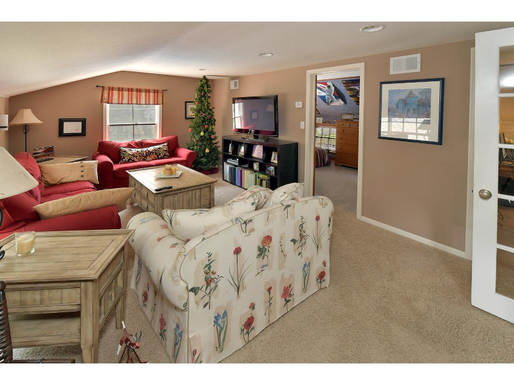 Along with four bedrooms on the upper level, enjoy the bonus room which is currently being used as the kids living room!