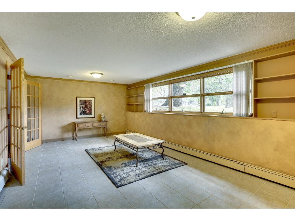 Lower level family room with French doors to the office.