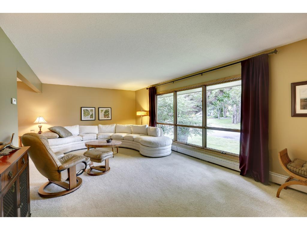 Living Room with an abundance of large windows and natural light.  Southern exposure