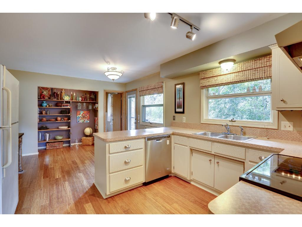 Kitchen with newer bamboo flooring and stainless steel appliances