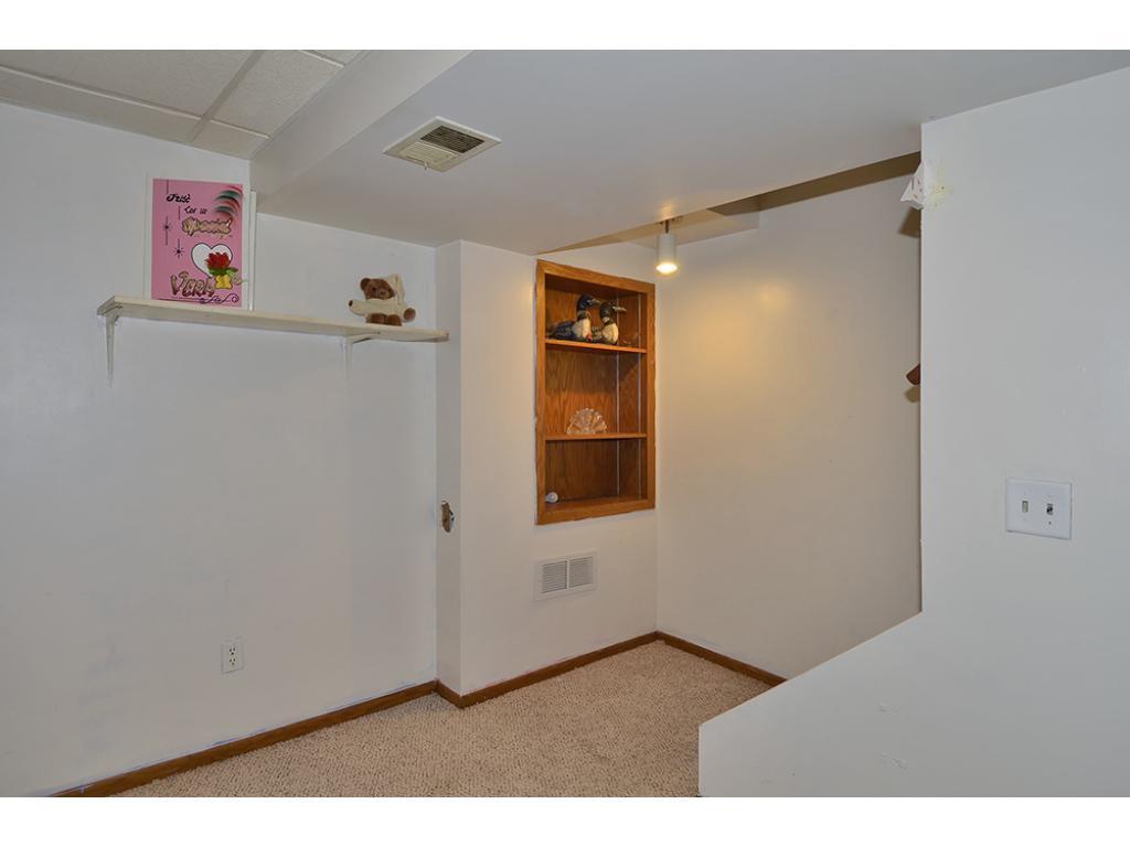 Lower Level Bedroom with Door to Laundry Room