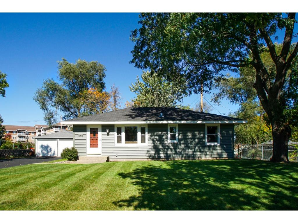 New siding, roof and windows!  Charming exterior on a beautiful, private home site!