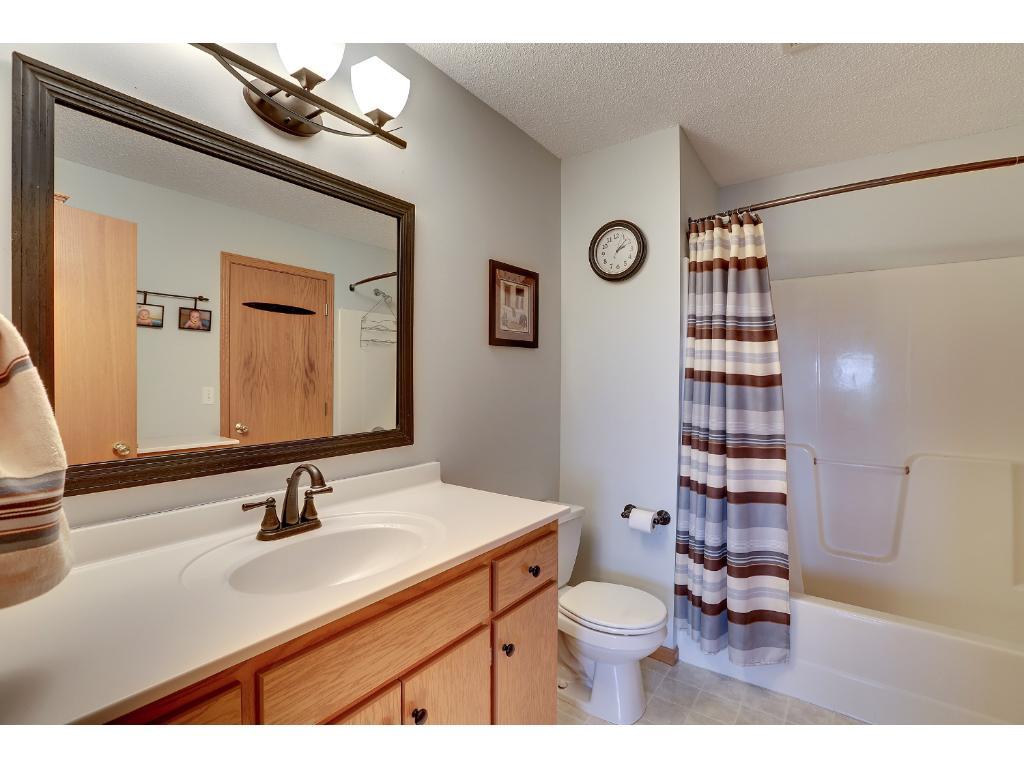 Walk-through bathroom on upper level.