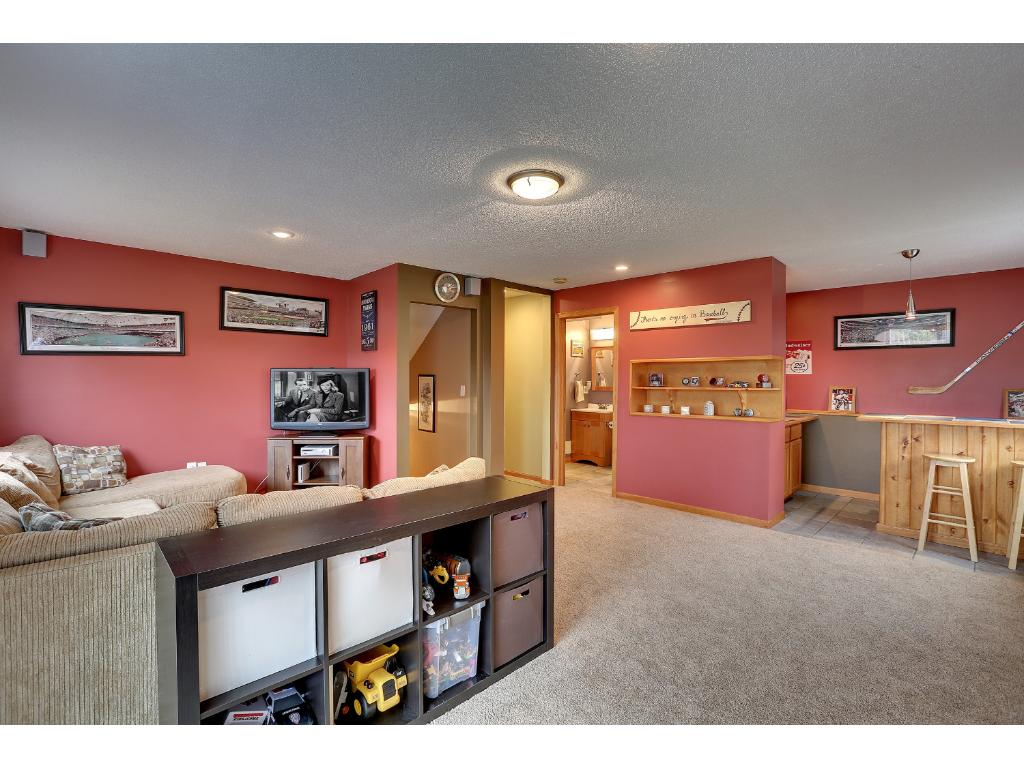 Down one set of stairs to the 3rd level with a large family room, wet bar, 3/4 bathroom, walk-out to patio and back yard.