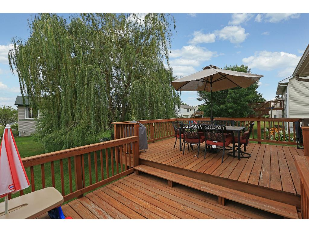 Large multi-level deck off back of house.