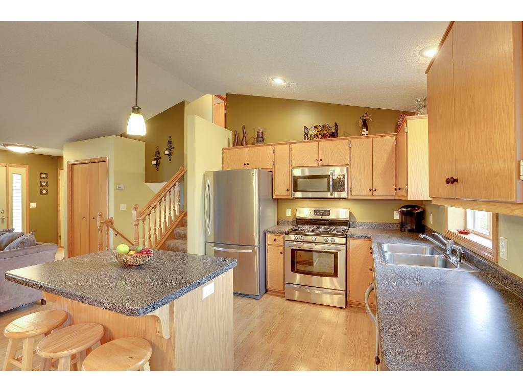 Great kitchen with upgraded stainless steal appliances. Lots of cupboard and counter space. Perfect sized island with stools.