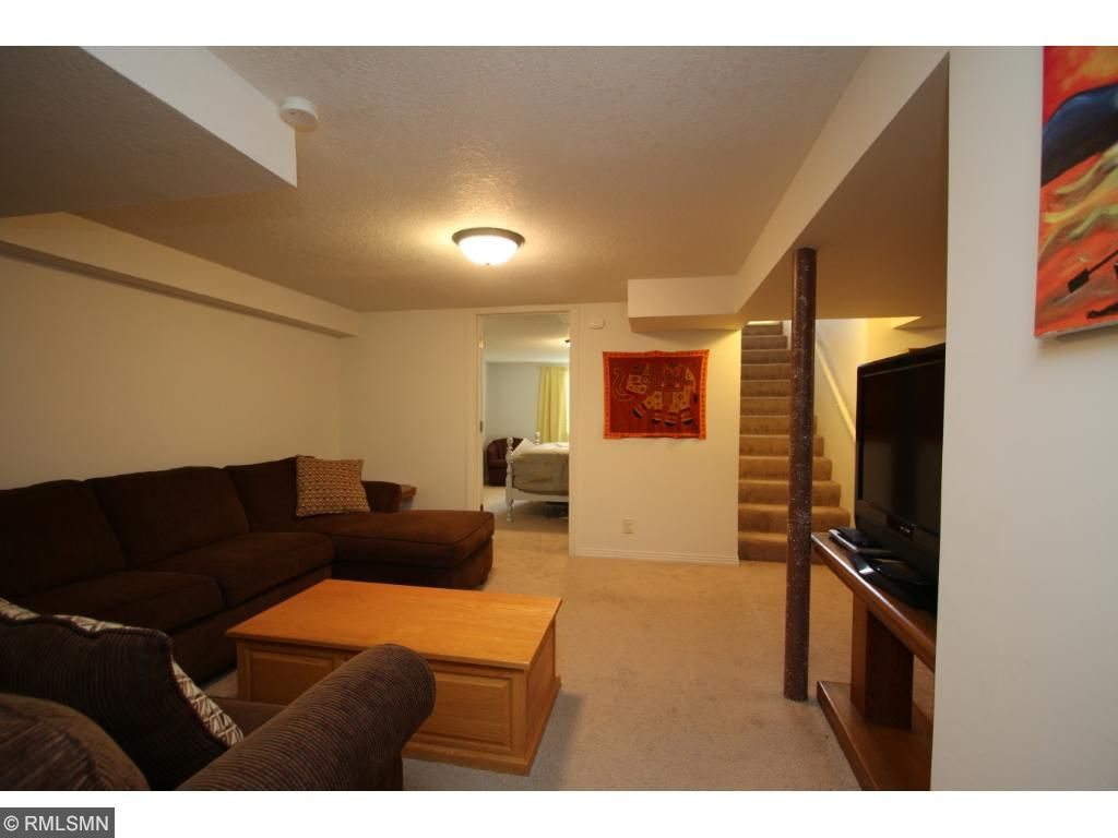 Lower level family room is ideal for a family to spread out