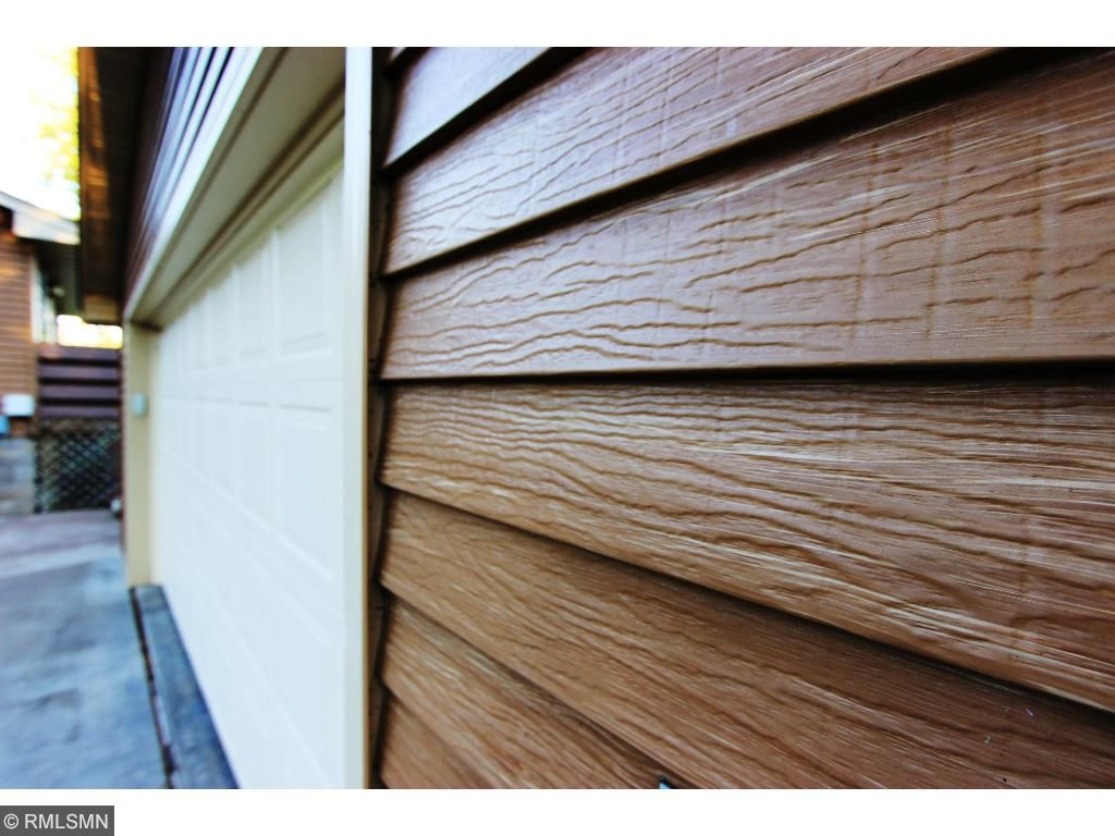 Maintenance Free, Heated Garage, with Steel Wood Grain Siding, Concrete Floor
